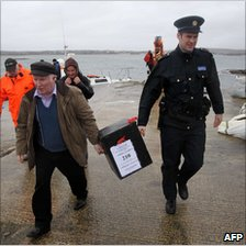 A ballot box is delivered to Inishfree Island, off the Donegal coast, 23 February