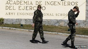 Soldiers walk outside the army academy in Hoyo de Manzanares, Spain, 24 February