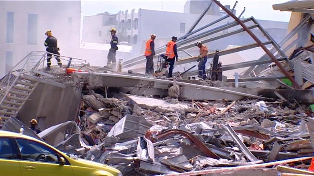 Rescue workers in the rubble
