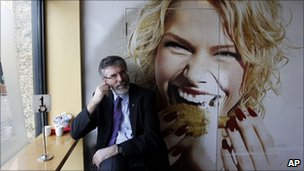 Gerry Adams of Sinn Fein stops for a cup of tea while campaigning in the village of Lunleer, County Louth, 24 February