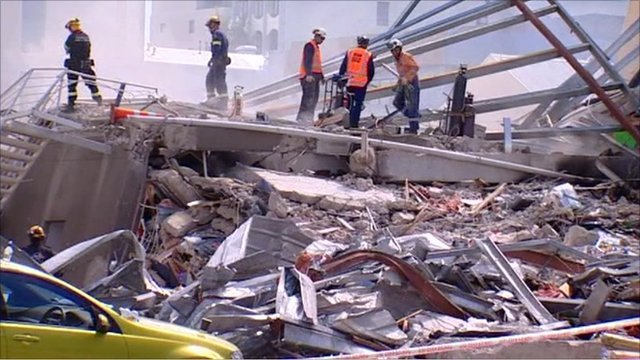 Rescue workers sort through rubble
