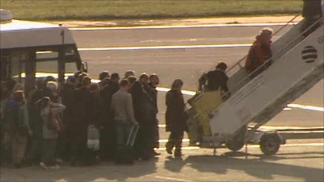Passengers board plane for Britain