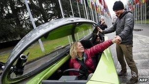 Team members on the Australian three-wheeler Trev celebrate the end of the trip in Geneva, 24 February