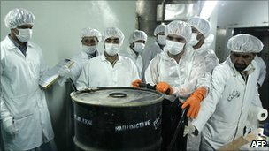 Iranian scientists with a sealed container of radioactive uranium, Isfahan (Aug 2005)