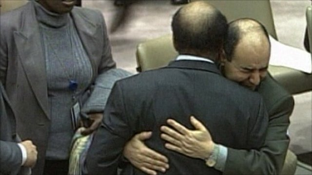 Mohamed Shalgham being embraced by Libya's deputy to the United Nations, Ibrahim Dabbashi