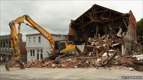 An earth mover is parked in a street to demolish a collapsed building in Lyttelton on 26 February 2011 in Christchurch, New Zealand.