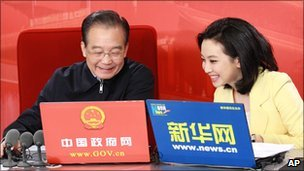 Xinhua photo of Wen Jiabao, left, preparing to hold online chat in Beijing, 27 February 2011
