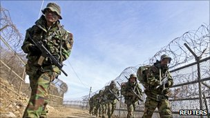 South Korean marines march during military training in Gimpo, west of Seoul, 25 February 2011