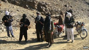 Taliban fighters during a patrol in Ghazni province on 23 January 2010