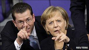 Karl-Theodor zu Guttenberg and Angela Merkel
