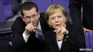 Karl-Theodor zu Guttenberg with Chancellor Angela Merkel in the Bundestag (Oct 2009)