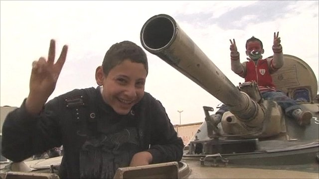 Libyan rebel children with a captured tank