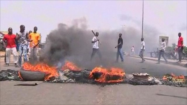 Pro Ouattara supporters burning tyres