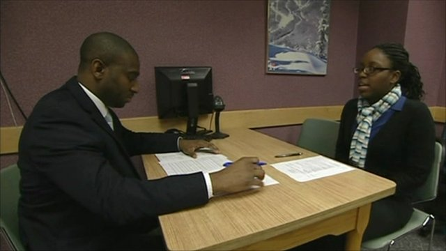 An unemployed lady receives CV tips at a career centre