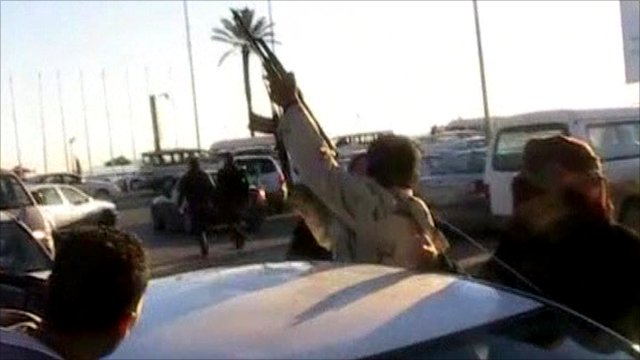 Man shooting rifle into air