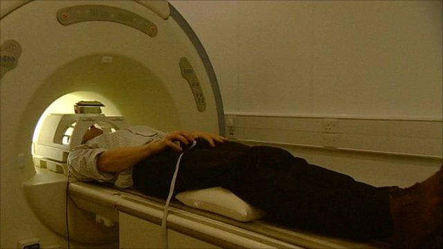 A man undergoes a brain scan