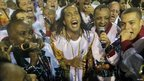Football star Ronaldinho (centre) sings to the music of the Grande Rio samba school in the second night of the annual Carnival parade in Rio de Janeiro's Sambadrome, 7 March, 2011.