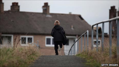 A boy on a housing estate