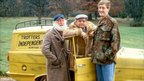 Buster Merryfield as Uncle Albert, David Jason as Del Boy Trotter and Nicholas Lyndhurst as Rodney Trotter all standing alongside the Trotters company van (the Robin Reliant), in series five of the comedy sitcom Only Fools and Horses, set in Peckham, South London.
