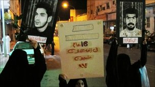 Protesters hold posters of prisoners during a demonstration in Qatif, Saudi Arabia (9 March, 2011)