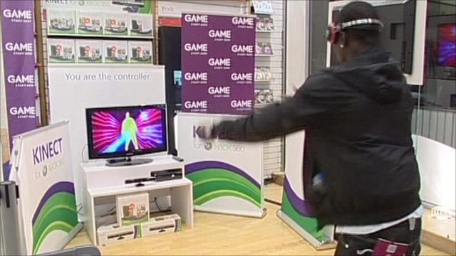 Man plays game with Kinect