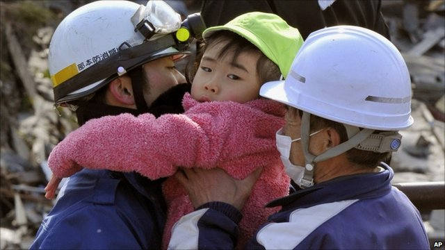Rescuers carry a child