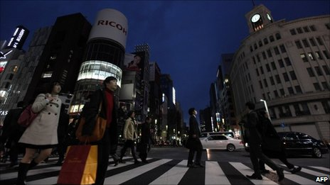 City lights and billboards are turned off at Tokyo's Ginza fashion district