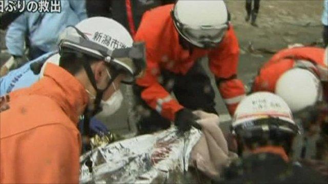 Rescuers with survivor