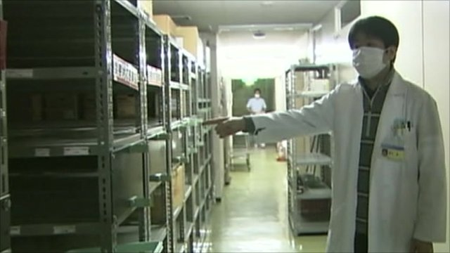 Doctor pointing towards empty shelves