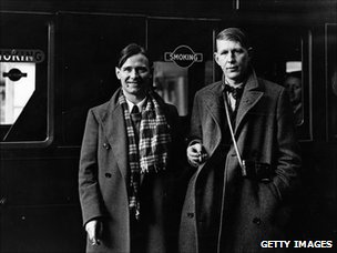 W. H. Auden with Christopher Isherwood at Victoria Station, London,