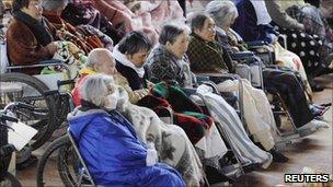 People in wheelchairs rest at an evacuation centre in Kesennuma, Miyagi Prefecture