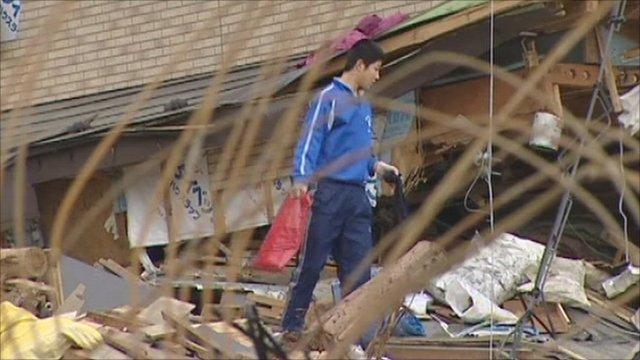 Man walking through rubble in Kamaishi, Japan