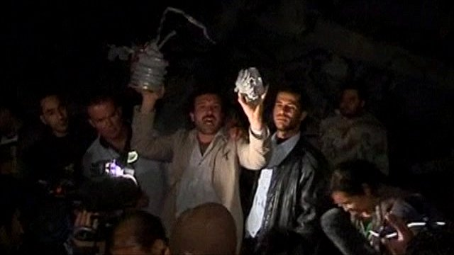 Journalists are shown the damage at the building in Col Gaddafi's compound