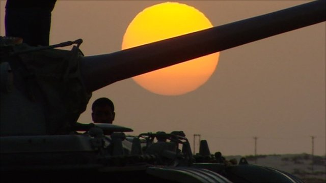 Tank with sunset behind it