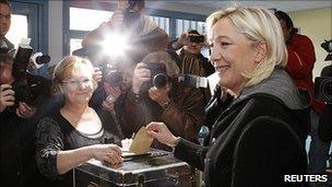 National Front leader Marine Le Pen casts her ballot, 20 Mar 11