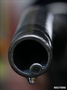 Fuel drips from the nozzle of petrol pump