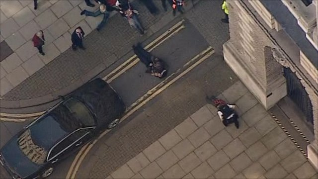 Protester lies in front of George Osborne's car
