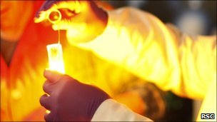 Chemist mixing chemicals in test tubes (Royal Society Chemistry)
