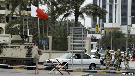GCC troops guard an entrance to Salmaniya Hospital in Manama, 18 March