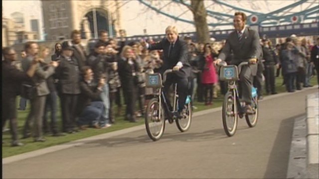 Arnold Schwarzenegger and Boris Johnson riding bikes