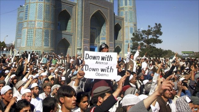 Protesters with ani-American banner