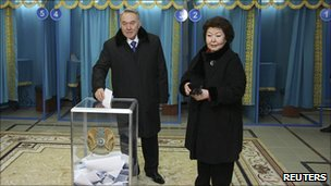 Kazakh President Nursultan Nazarbayev and his wife Sara cast their votes at a polling station in Astana
