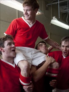 Jack O'Connell (held aloft) with other members of the United cast