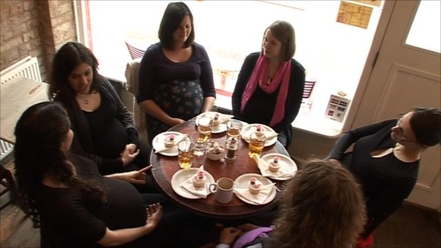 Expectant mothers around a table