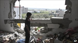 A Palestinian child in his damaged family house in Gaza City, 8 April