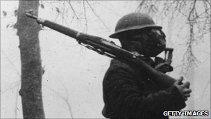Soldier with gas mask in World War I