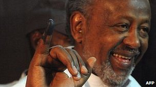 Incumbent President Ismael Omar Guelleh shows off his inked finger after voting