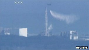 Helicopter dropping water on Fukushima