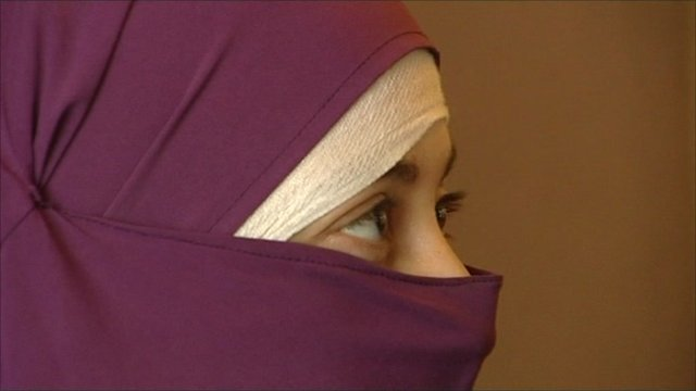 Woman wearing veil over face