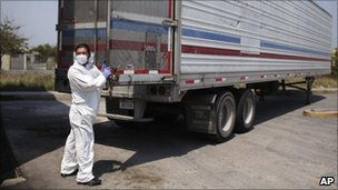 Morgue employee unloading bodies on 8 April, 2011